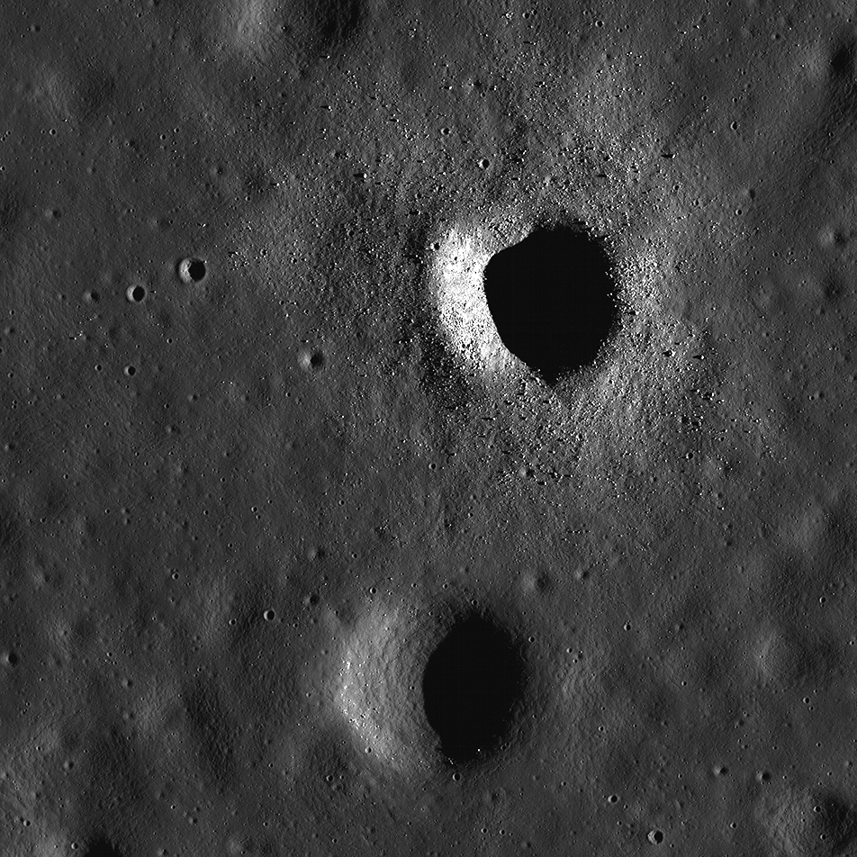 Similarly sized craters, one is fresh and the other is old.
