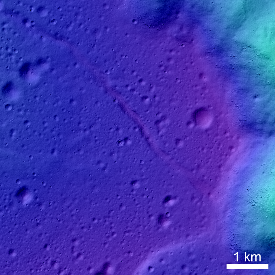 Colorshaded relief showing the edge of Tsiolkovskiy crater at the right side of the image. The 3/4 of the image to the right show the cratered flow of Mare Tsiolkovskiy.