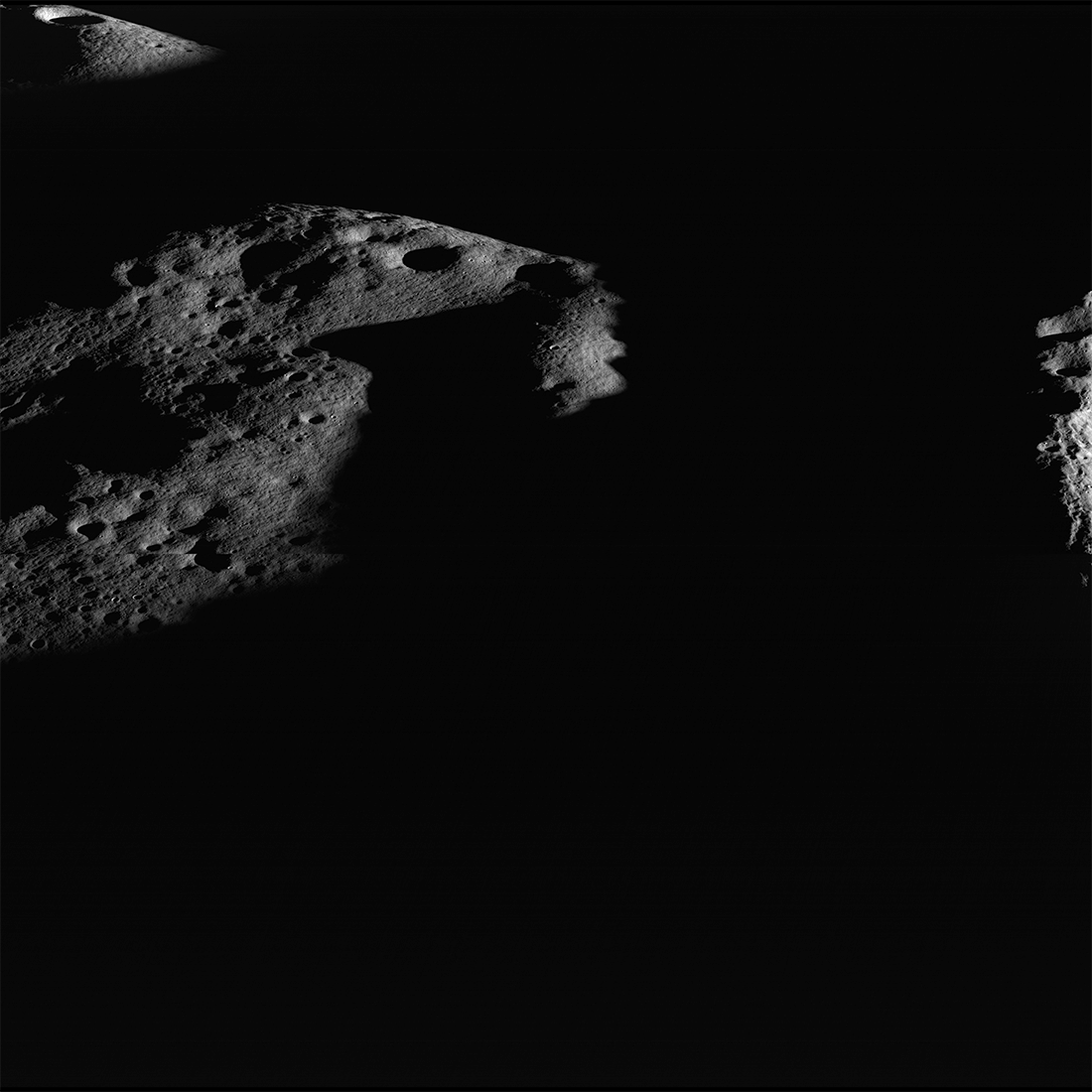 Image of illuminated peaks near the rim of Shackleton crater